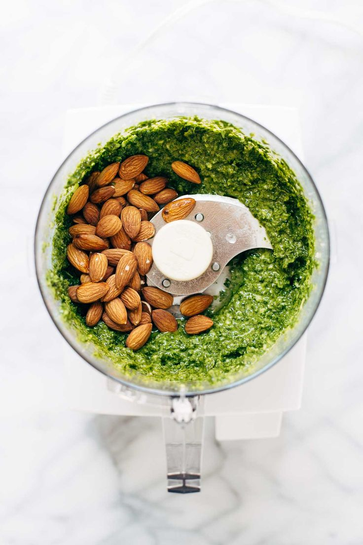 5 Minute Vegan Kale Pesto - made with almonds, olive oil, kale, garlic, salt, and lemon juice. So easy, so healthy, so good! | pinchofyum.com