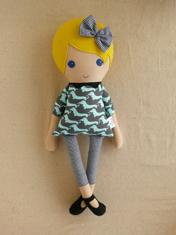She will do a Custom doll. These dolls are My fav of the ones I have found....Fabric Doll Rag Doll Blond Girl in Gray and Blue Dog Print Dress. Obviously savs would have brown hair brown eyes. $34