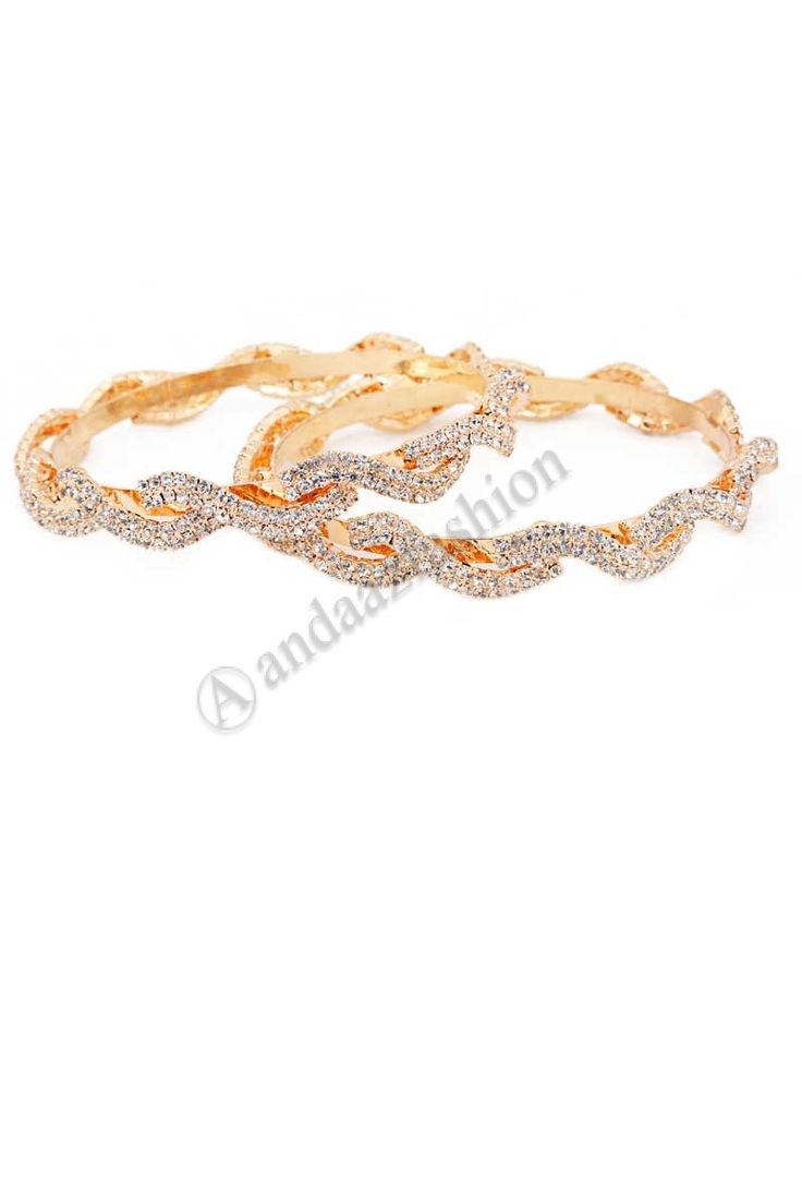 Crystal Kangan  Design No. 80360 Price:- £7.00 Product Type:	Kangan Material:	Alloy Colour:	Golden Embellishments:	Golden Crystal studded kangan set For More Details:- http://www.andaazfashion.co.uk/jewellery/bangles/crystal-kangan.html