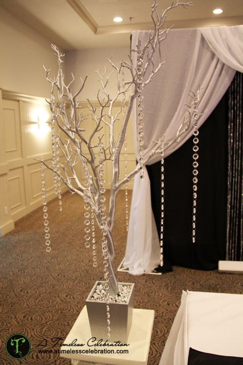 Silver tree with hanging acrylic crystals wedding reception centerpiece | A Timeless Celebration Events Styling & Management Montreal