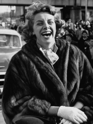 I love this picture of Rosemary Clooney. Compared to most of the others where she's posed, perfectly coiffed and acting demure, this strikes me as the most real, most human picture of joy on her face. Love it.