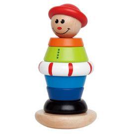 Dit blijft leuk! Met de kleurrijke houten ringen kunnen kinderen dit poppetje van top tot teen aankleden.