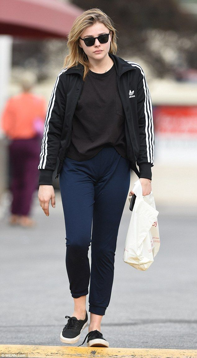 chloe moretz opts for comfort in adidas track jacket while