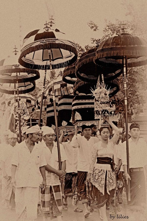 Ceremony in Ubud,Bali using ceremonial umbrellas. Families have been making these umbrellas for centuries. At The Indian Garden Company we take these traditional designs and with the artisans adapt them for Western climatehttp://www.indiangardencompany.com/sun-umbrellas/the-paradise-collection.aspx