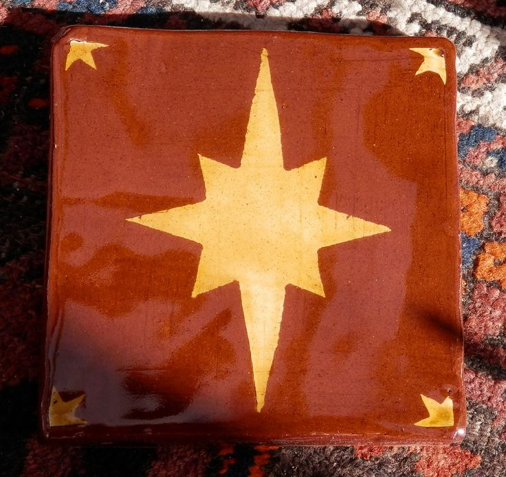Star - inlaid medieval-style tile by Tanglebank Tiles
