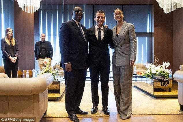 Senegalese President Macky Sall, Barbadian singer Rihanna and French President Emmanuel Macron pose a they attend the GPE Financing Conference