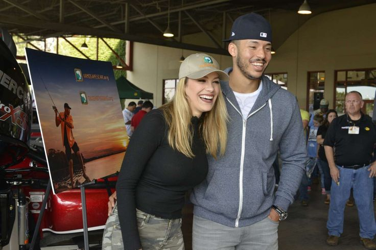 Astros' Carlos Correa, fiancee surprise kids at fishing clinic  -  December 4, 2017.  Houston Astros' World Series champion Carlos Correa and his fiancŽ Daniella Rodriguez in partnership with Vamos A Pescarª share their passion for fishing and boating with over 100 families at Bass Pro Shops Katy on Saturday, Dec. 2, 2017, in Katy, Texas. (Anthony Rathbun/AP Images for Bass Pro Shops)