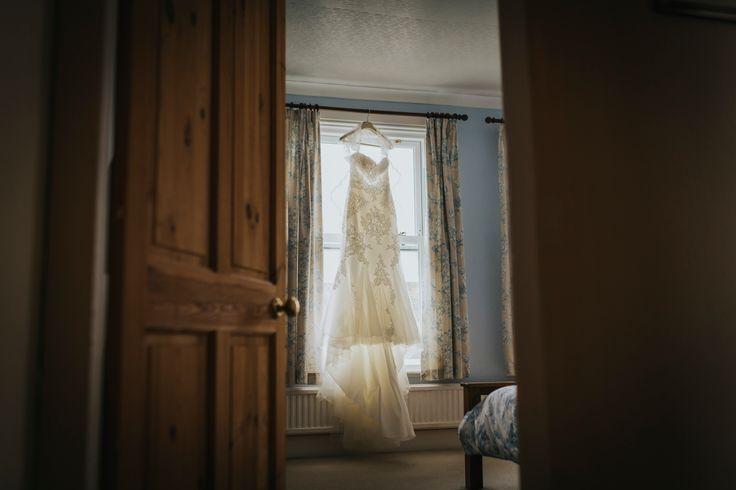 Lovely lace detailing and long train. Photo by Benjamin Stuart Photography #weddingphotography #weddingdress #bride #weddingday #lacedress
