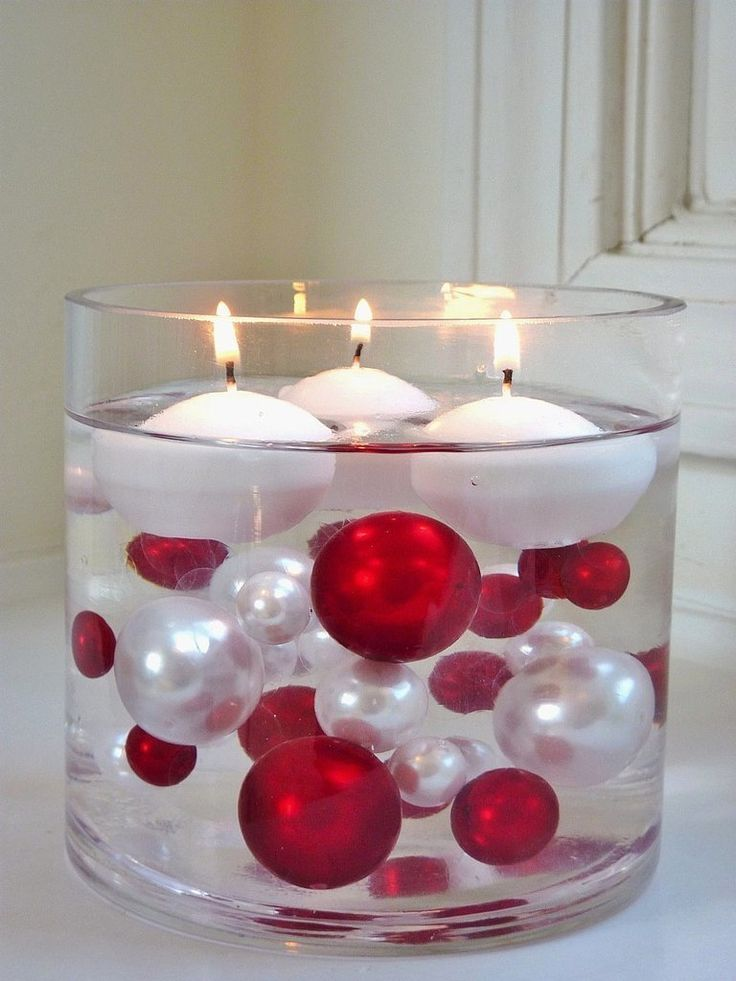 This one's easy: gather festive-colored beads and place them inside a transparent vase filled with water. Get them to float by picking up a pack of water gels for cheap.