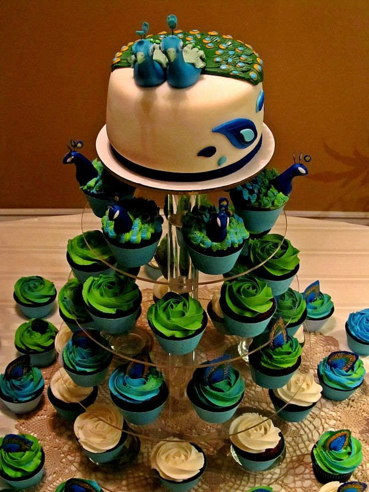 Peacock wedding cake/cupcake tower  https://www.facebook.com/TheresaCahill#!/pages/CAKEbydesign/121926347848081  My Amazing Aunt!