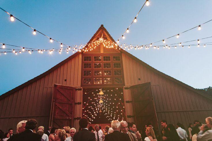 barn wedding twinkle lights at Santa Lucia Preserve barn