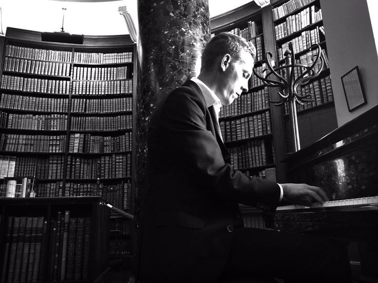 """""""Perks of the job. Oriel college library. Steinway."""" from laurence fox's tweet on 9 jul 2015 at location in oxford."""