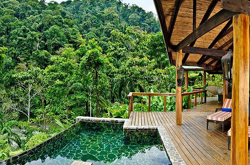 Pacuare Lodge is in the middle of the rainforest, and you can take your meals in a sky-high treehouse! Located along the Pacuare River, in the middle of the rainforest | 12 Places To Stay In Costa Rica You Won't Believe Actually Exist
