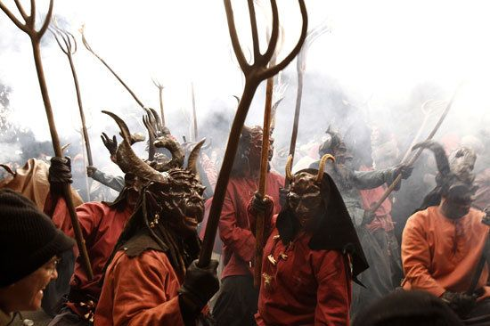 Participants wearing demon costumes take part in the traditional festival of 'Atiar Foc' in Palma de Mallorca, on January 22, 2011. The annual festival of Atiar Foc, is a night of revellry in which participants dress as demons and devils, and move through the streets scaring people with fire and fireworks.  Ugh.