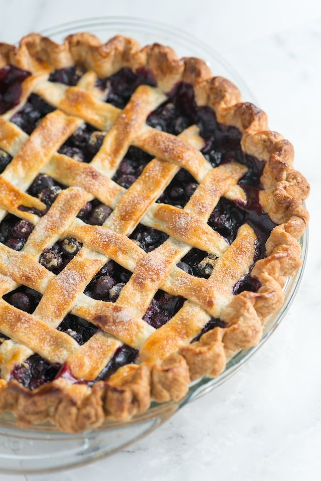 A simple blueberry pie recipe with blueberries, warm spices, lemon and an easy lattice crust. Tips for making with fresh or frozen blueberries included. Recipe video included! From inspiredtaste.net   @inspiredtaste