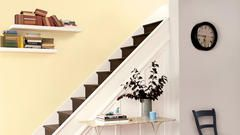 Use creamy yellow shades in a hallway to add warmth and light.
