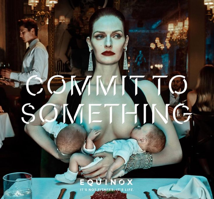 A model breastfeeds two babies in Equinox's 2016 advertising campaign