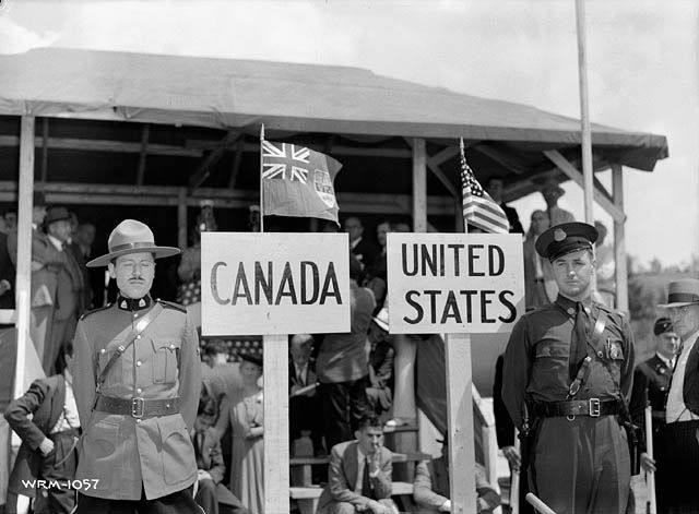 A Royal Canadian Mounted Police officer and a state trooper at a ceremony commemorating the joining of a pipeline between Quebec and Maine, August 1, 1941