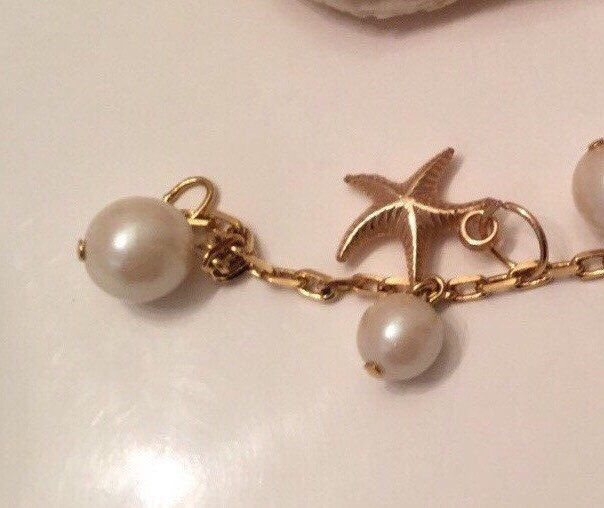 A personal favorite from my Etsy shop https://www.etsy.com/ca/listing/234610748/gold-tone-starfish-charm-bracelet