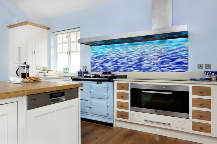 Rich ocean colours bring moverment and life to this unique fused glass splashback, creating a dramatic wave effect. This Sea (wave) splashback is over 2.2metres wide and has been made in two sections, which have been neatly joined together.