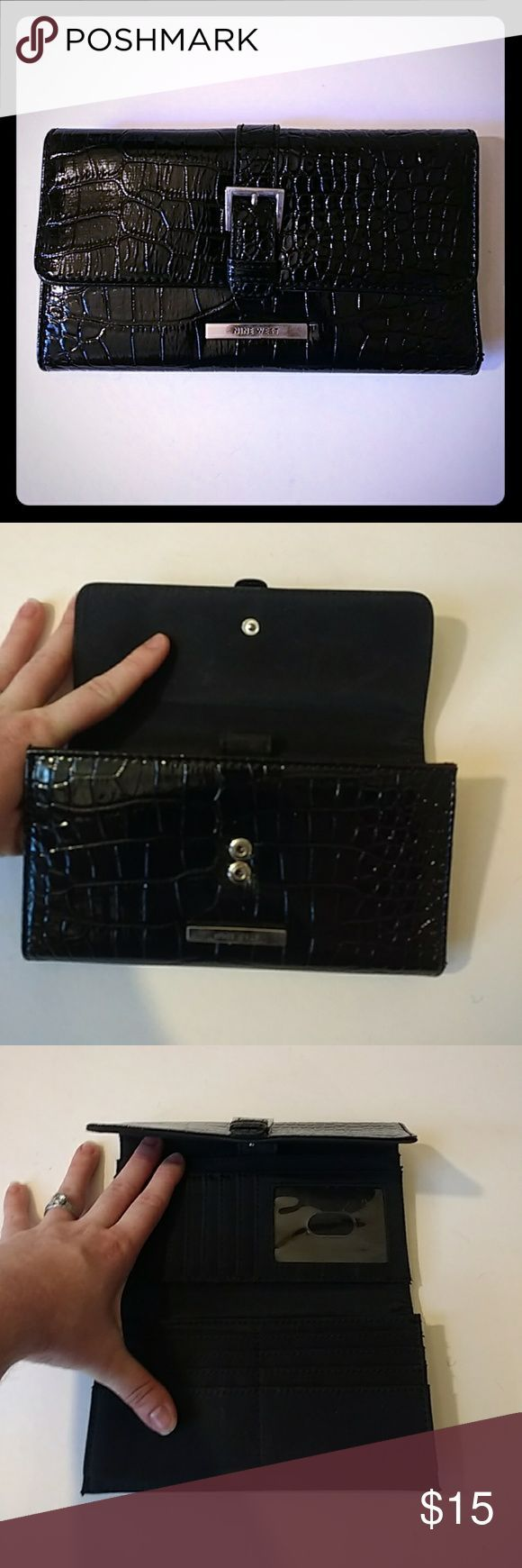 NWOT Nine West Faux Alligator Skin Long Wallet This is a brand new Nine West wallet that features a black faux-leather with an alligator-like print. It features a myriad of pockets as card slots. I never used it because I honestly forgot I had it. Comment with questions! Nine West Bags Wallets