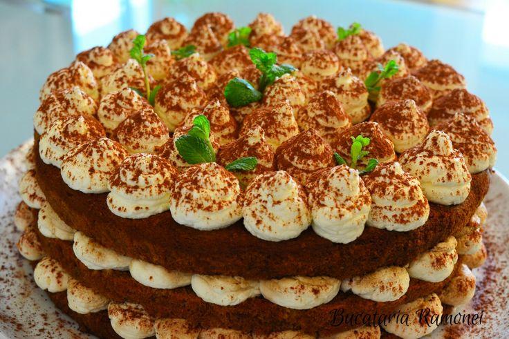 Tort tiramisu cu crema mascarpone fara oua este un desert foarte aspectuos, aromat, cremos si pufos care se preapara foarte usor. Se pregateste cu o crema la rece de mascarpone aromata si pandispan simplu insiropat cu cafea. Este potrivit pentru orice...Gasesti reteta aici: http://bucatariaramonei.com/recipe-items/tort-tiramisu-cu-crema-mascarpone-fara-oua/