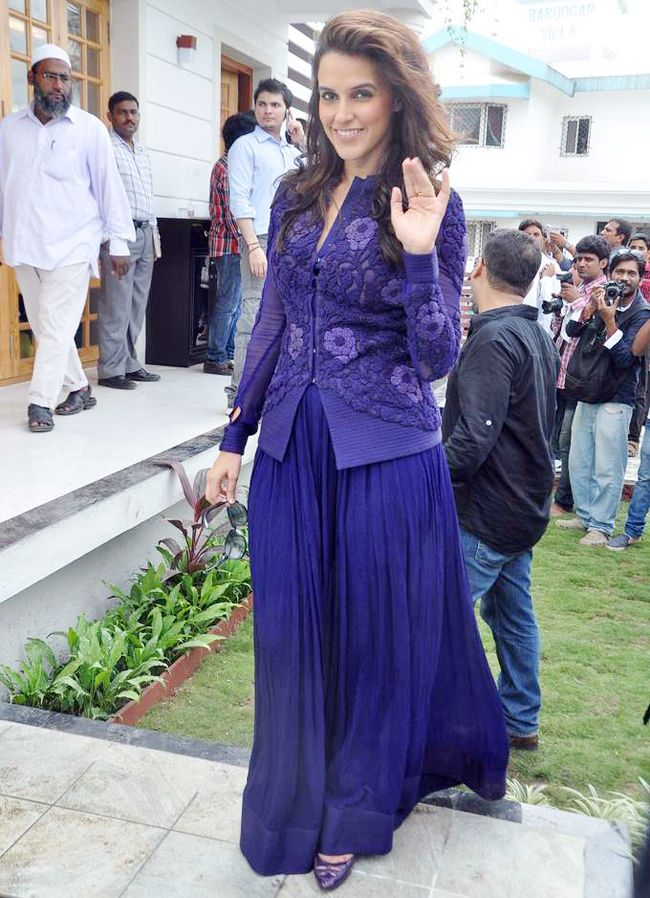 Neha Dhupia looking elegant in a purple two-piece, floor length skirt and top at…
