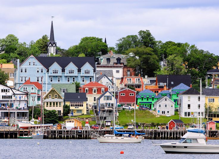 Lunenburg Lunenburg, Canada outdoor Boat water Town geographical feature scene neighbourhood residential area human settlement River vacation cityscape waterway vehicle Harbor Coast Village docked several