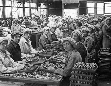 Women munition workers finish small arms cartridges in Small Arms Cartridge Factory No.3 at Woolwich Arsenal, London, during the First World War. (Artist: Lewis G P)