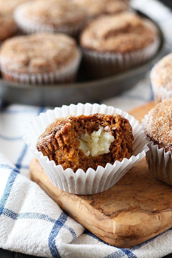 Pumpkin Cheesecake Snickerdoodle Muffins are tender pumpkin muffins stuffed with cheesecake...
