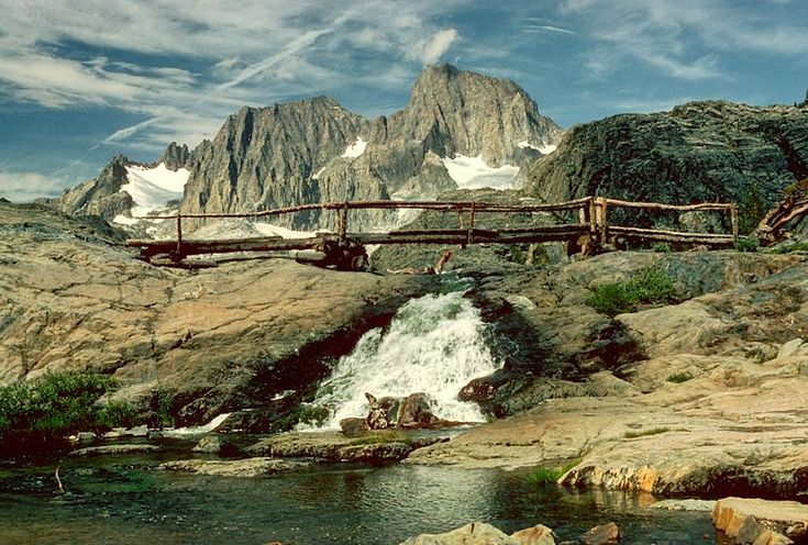 Wooden bridge grants passage through the John Muir Trail. Photo by Wiki Commons