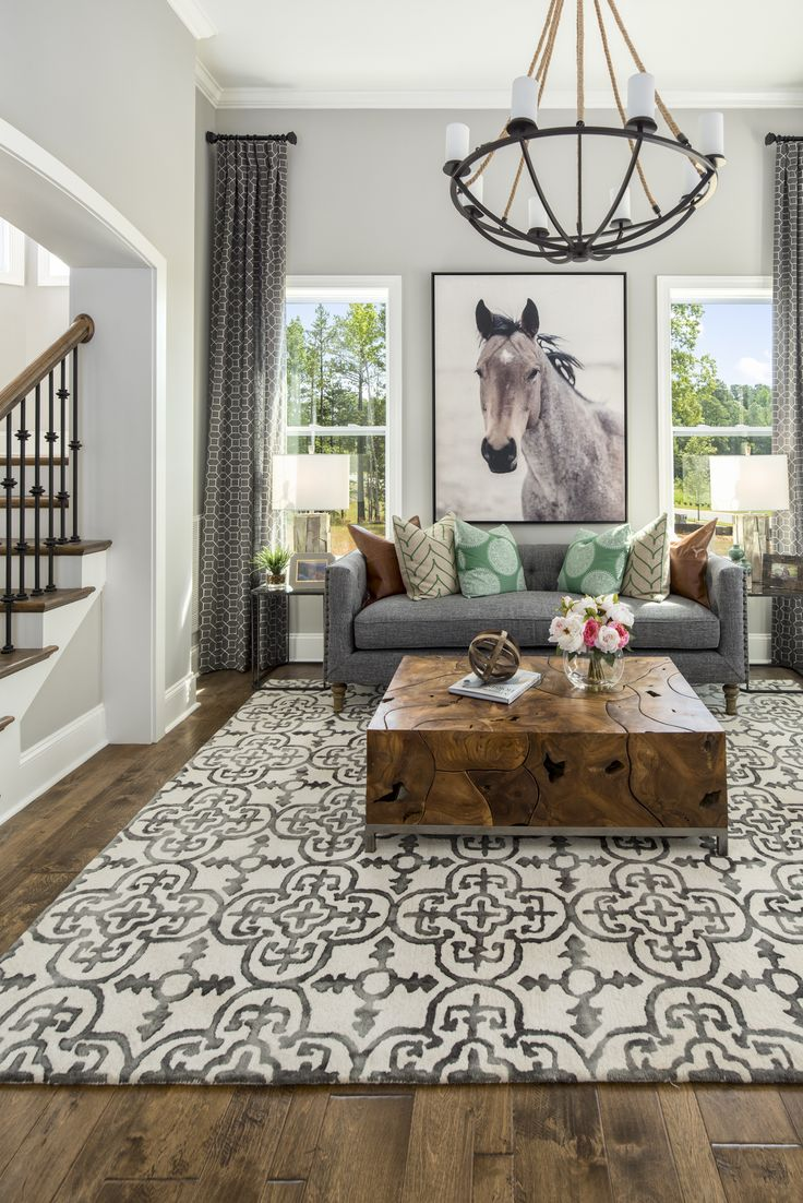 Equestrian rustic sitting room with patterned carpet. This Bel Aire model at Massey is located in Fort Mill SC