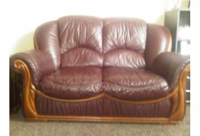 Can't argue with the price! Pair of burgundy leather two seater sofas