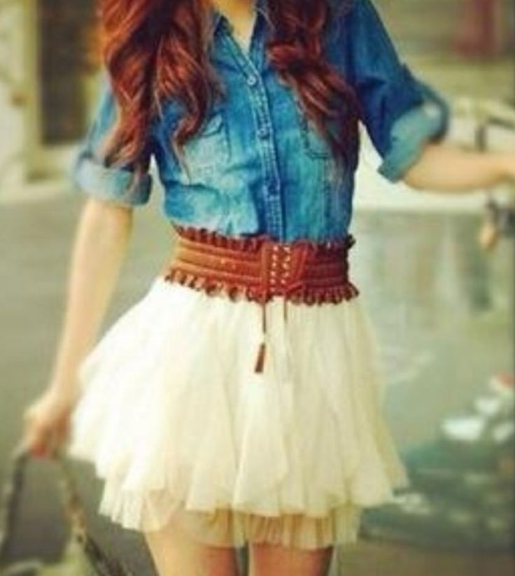 Denim shirt, chunky belt, and short frilly skirt. Don't forget to add the boots