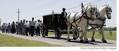 Louisiana State Penitentiary:  In 1998, inmates built a black, horse-drawn hearse modeled after an 1800s vintage funeral coach for use during the burial rites.  It is pulled by two large white Percheron horses.  The hearse is driven by an inmate dressed in a black tailcoat and a black high hat.  Six pallbearers follow the coach on the road to the cemetery and assist with the burial.  Inmate ministers conduct the service.