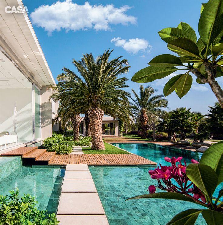 Jardim contemporâneo mistura volumetria e espaços vazios - Casa