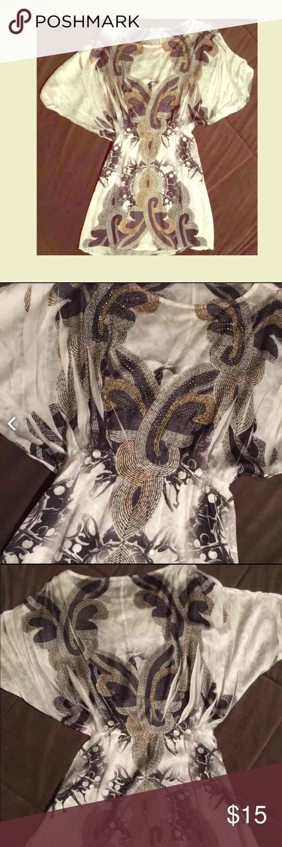 ✨White Multi Colored Dress✨ 🎀Gently used White Multi Color dress by Papaya. Size is a medium. Has beautiful design throughout the whole dress. Light material. Great for going out in. Only worn this dress once🎀 Papaya Dresses Midi