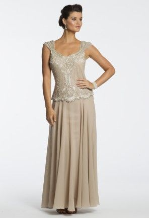 Imagine just how stunning you will look wearing such a theatrical design as your mother of the bride dress on your so very memorable day. An all beaded and scallop edged bodice slims in your waist for the most figure-flattering silhouette that you could ever imagine. A regal capped sleeve, adorned with beading, and long flowing skirt complete this tasteful formal look and brings a very elegant flair to the whole ensemble. This style will always be a magnificent guest of wedding dress or ...
