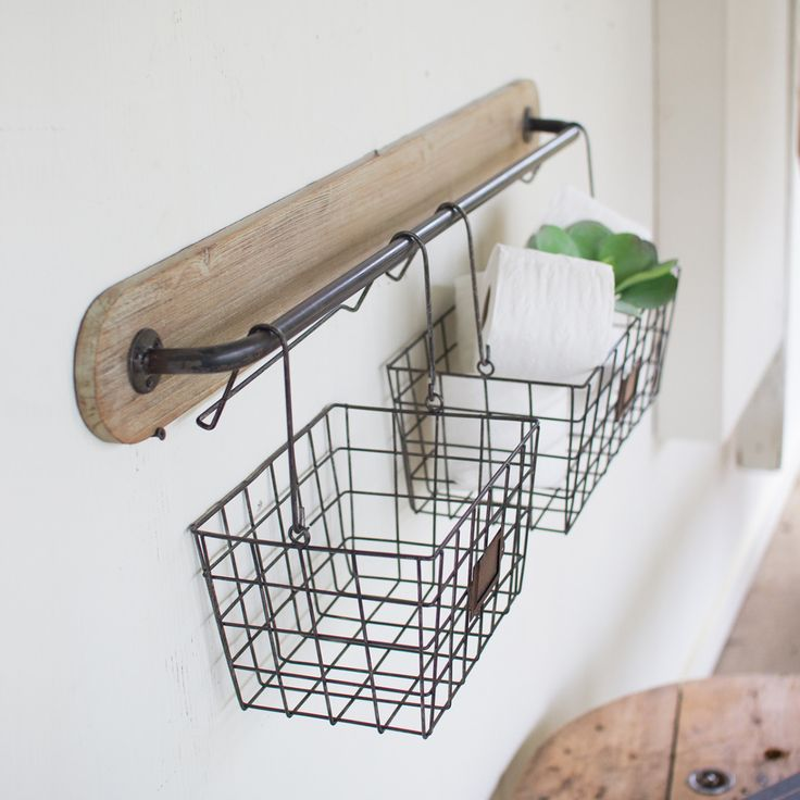 With Two Sizable Wire Baskets, This Anderson Wall Bracket Will Hold  Anything From Spare Toilet Paper Rolls .