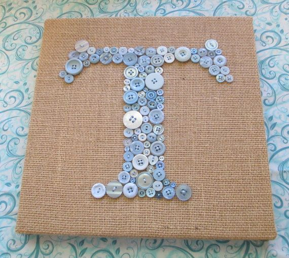 "I love this 12""x12"" ""T"" for Talia's room - $90 (each new & vintage button is hand sewn into place w/ strong embroidery thread. Button monogram is then secured onto burlap. Set it by a lamp or window so the buttons can reflect the light! Sizes from $60 (8""x10"") - $150 (16""x20"")"