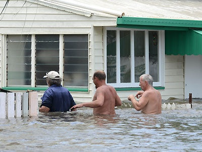 Residents clear belongings from their houses about to be flooded in East Bundaberg, Queensland, Australia. 26 January 2013.