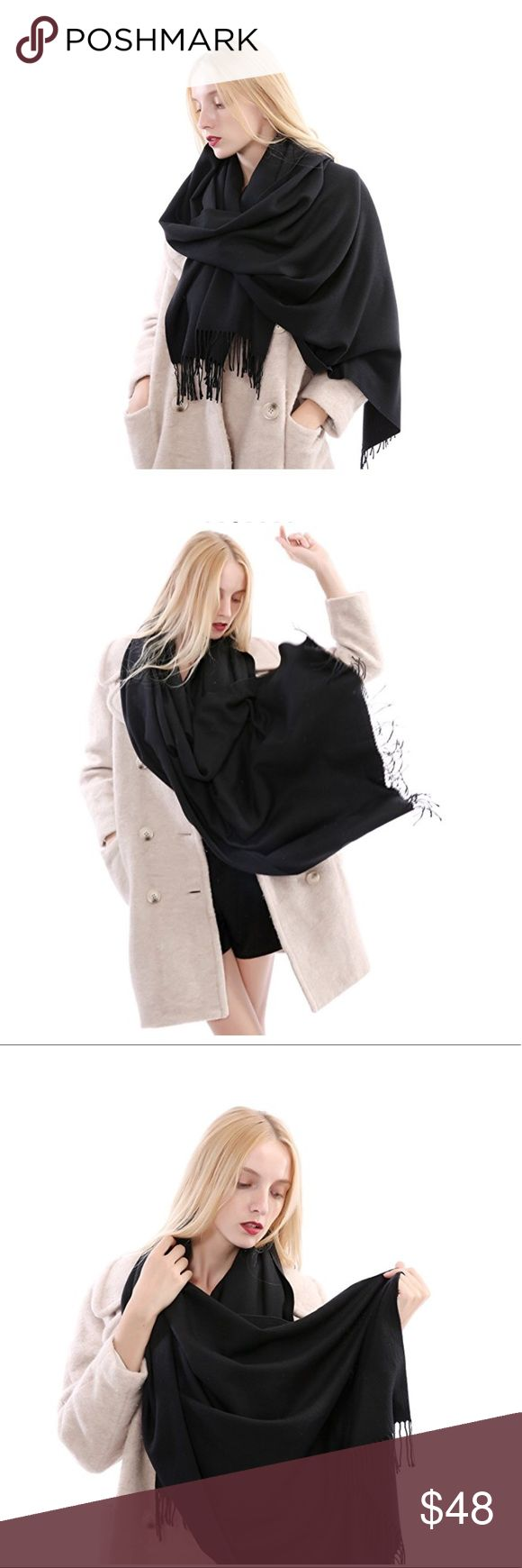 Black Cashmere Blanket Scarf This gorgeous, luxuriously soft blanket scarf is a the perfect layering piece for winter and works equally well to keep you toasty at the office, too.  Fabric composition is 35% cashmere, 65% cotton.  Bring yours home today! Lalea Accessories Scarves & Wraps