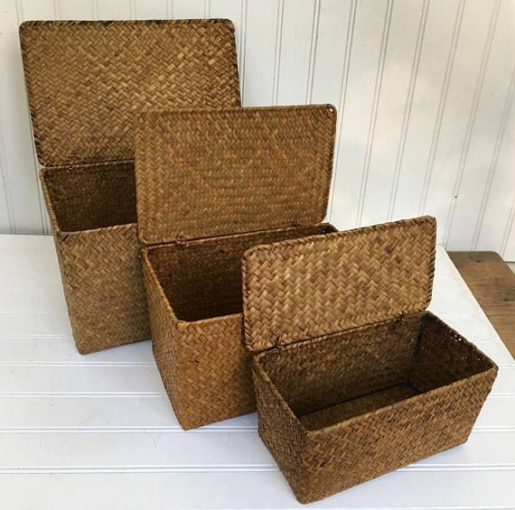 Vintage Wicker Nesting Storage Boxes with lids  This vintage set of nesting storage baskets includes 3 different sized baskets. The largest measures approx. 11 x 7 x 7. The mid-sized basket measures 9 1/2 x 5 3/4 x 5 3/4. The smallest basket box measures 8 3/4 x 4 1/2 x 4 1/2. Each basket has an attached lid that lifts to open. These nesting basket boxes are unique and can be used for storage as well as for home decor.  They are in vintage condition and do have s...