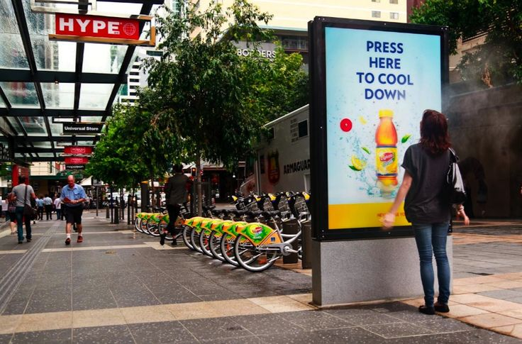 "http://www.campaignbrief.com/2011/12/version10-starthtml0000000149-100.html  Lipton Ice Tea's ""Never lose your cool"" campaign was launched in the beginning of summer in Sydney, Australia. Misting stations were placed in underground train stations, bus stops, shopping centers, and beaches. These standing directory type installments would spray mist  during the morning and afternoon peak travel periods to give commuters a refreshing experience."