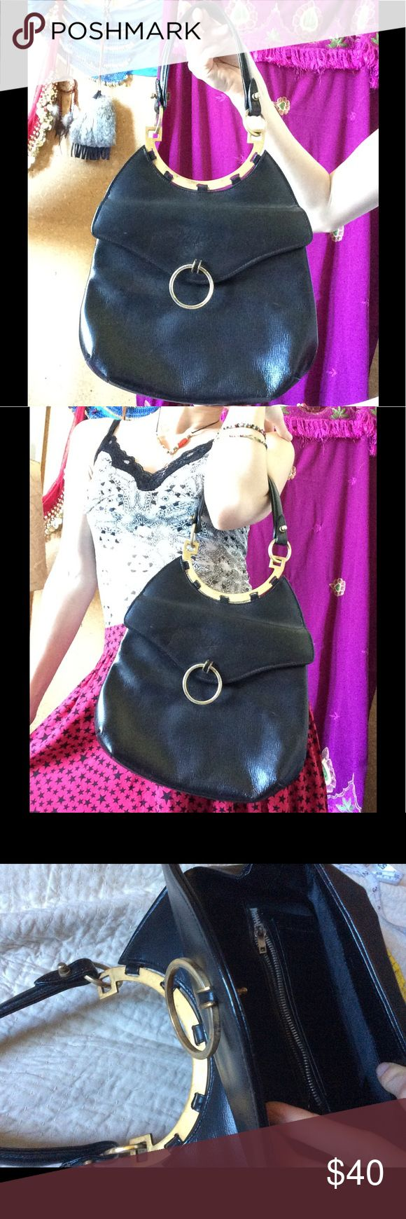 True Vintage Metal Moon 🌙 Arch Leather Purse Golden hardware. Black single strap handbag. Front flap that opens. Inner zipper is stuck from age. Mod, space and simple chic. Complete your Viva Las Vegas outfit. 60's. Mod. The curving metal arch reminds me of Egyptian collar necklaces. (I actually got this at the same sale I bout some Miss Egypt Couture dresses - le Cairo) circle keychain on front could have feathers, tassels or fringe added for fun. Good condition. No outer scratches. Smoke…