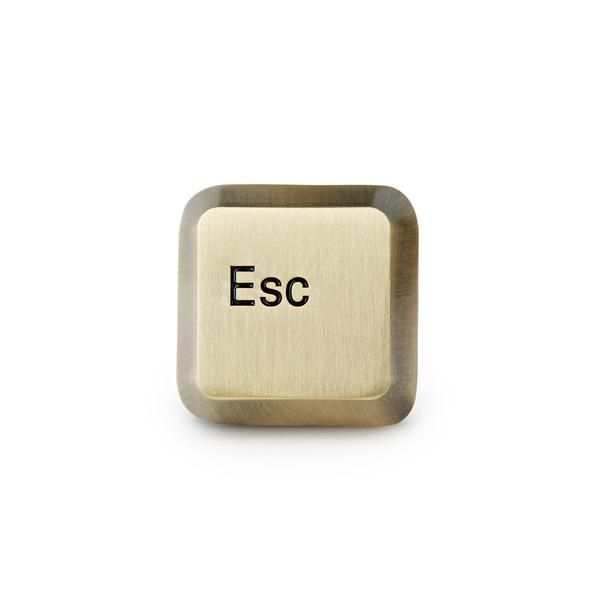 """When you wish real life had an esc key. ◆ 1"""" 3D lapel pin◆ Locking clutch backing◆ 7mm thick◆ Antique brass plating◆ Made in the USA"""
