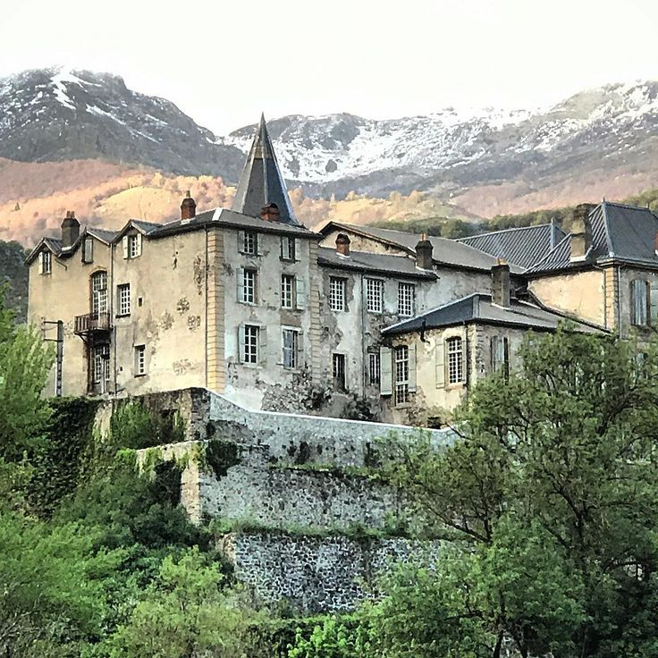 Magnificent facade of a French chateau in the mountainside. South of France Fixer Upper Château Gudanes. #southoffrance #frenchchateau #provence #frenchcountry #renovation