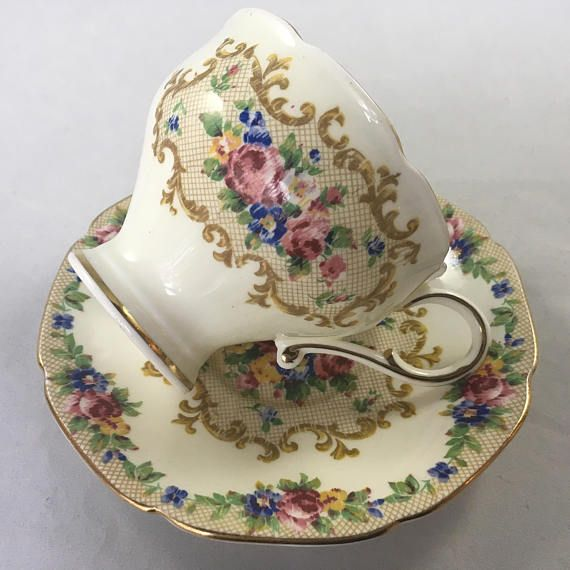"Paragon Minuet Teacup and Saucer, Corset style Lovely vintage corset Paragon Set Double warrant Excellent condition No chips cracks or crazing Gold gilt Measures: Cup opening 3.3"" Including handle 4.3"" Saucer 5.3"" *Combined Shipping is Available for Multiple Purchases* GIFT"