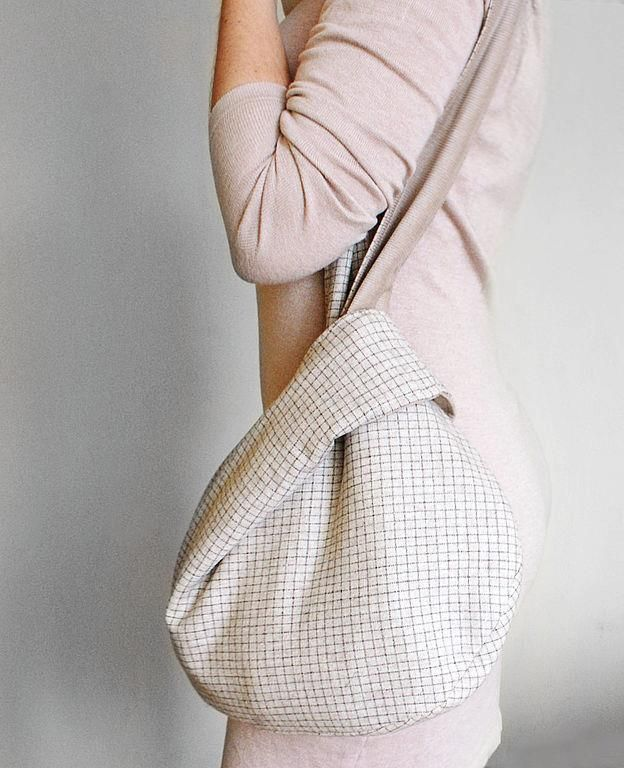 This is an example of a  Japanese knot bag with a long strap. I would probably wear it as a crossbody style bag.