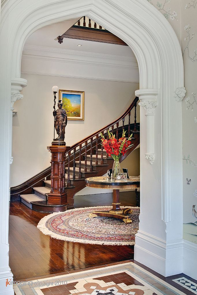 Stairs, bannister and an awesome doorway.  This house must be spectacular to see in person ~